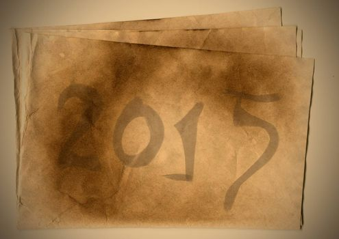 Happy New Year 2015 on old paper with the inscription