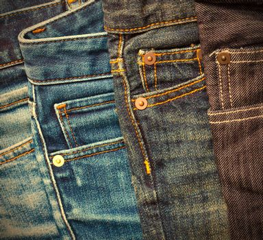 pile of blue and black jeans. instagram image retro style