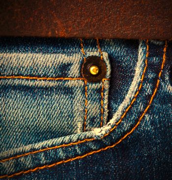 part of jeans with a brown leather belt, close up. instagram image style