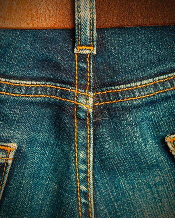 old blue denim with seams and leather belt. instagram image retro style