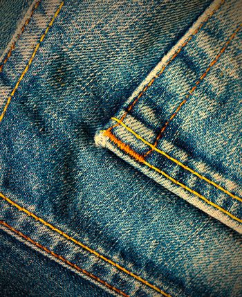 aged blue denim with seams,  close up. instagram image retro style