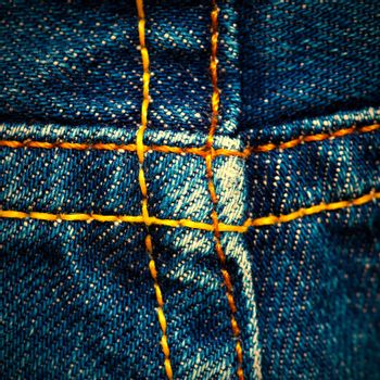 old jeans surface with seams, close up. instagram image retro style
