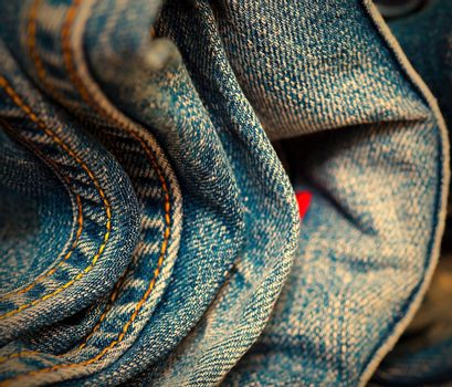 stitching on blue jeans, close-up. Shallow depth of field. instagram image retro style