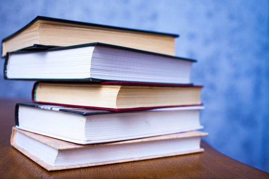 stack of book on the wooden table