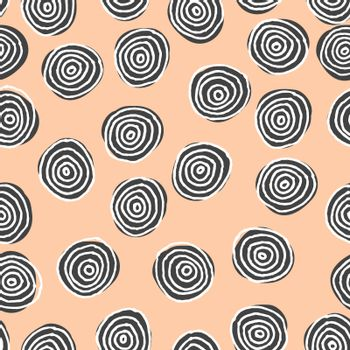 Hand drawn abstract seamless repeat pattern with round shapes in black and white on a pastel pink background.