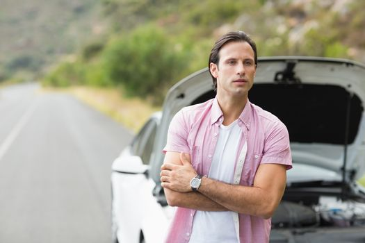 Man waiting assistance after a car breakdown