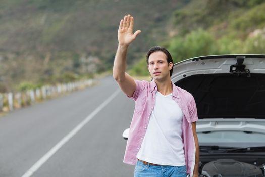 Man waving after a breakdown