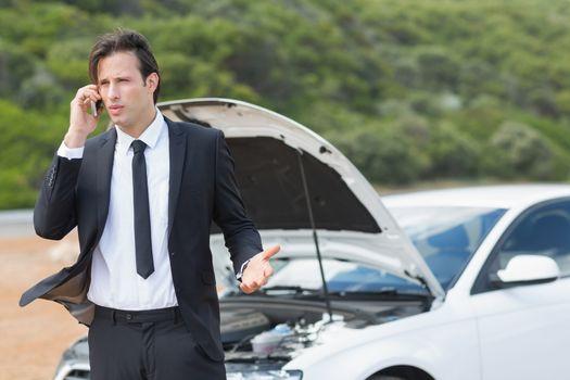 Businessman after a car breakdown