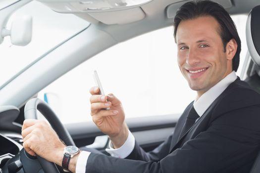 Businessman sending a text message