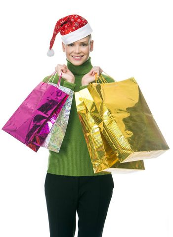 blonde smiling woman with christmas hat holding gift bags