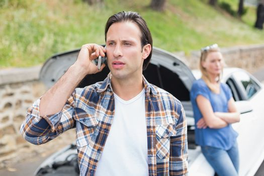 Couple after a car breakdown