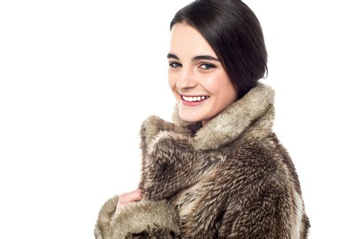 Stylish young girl in fur jacket