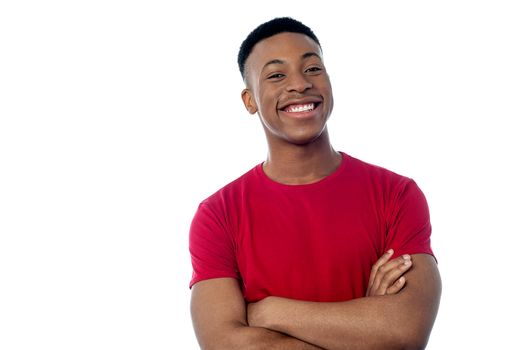 Young man posing with folded arms