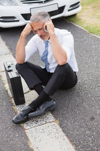 Sad man calling for assistance after breaking down