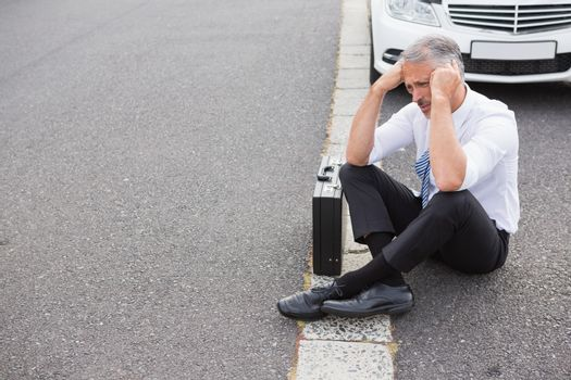 Sad man waiting for assistance after breaking down
