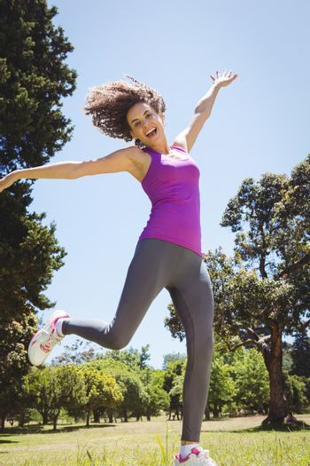 Fit woman leaping in the park