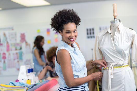 Portrait of female fashion designer at work