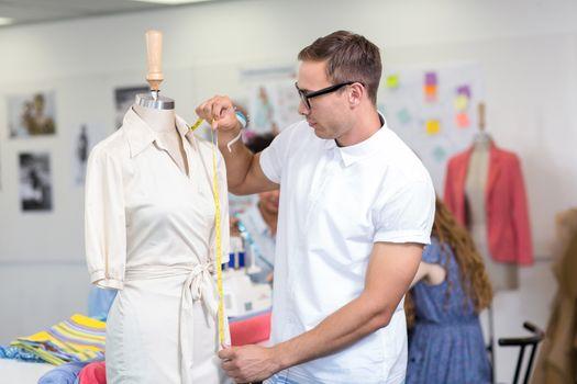 Portrait of male fashion designer at work