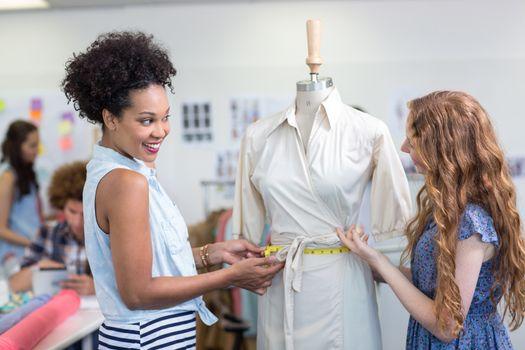Portrait of female fashion designers at work