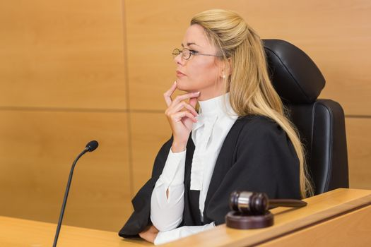 Stern judge looking and listening