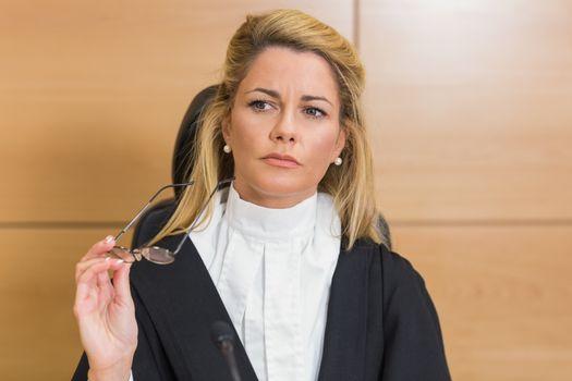 Stern judge looking away