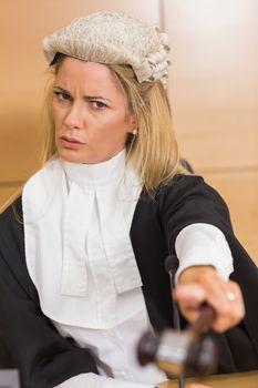 Stern judge pointing her hammer
