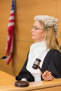Stern judge sitting and listening