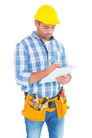 Manual worker writing on clipboard