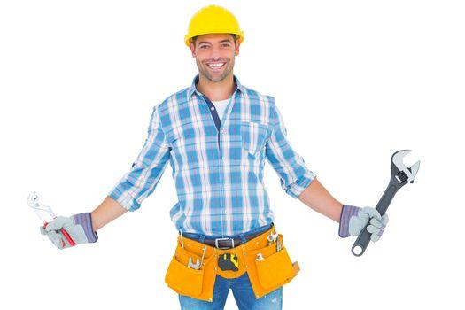 Portrait of handyman holding hand tools