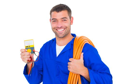 Smiling electrician with rolled wire and multimeter