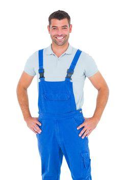 Portrait of happy repairman in overalls