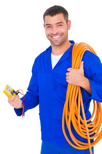 Smiling electrician with wire roll and multimeter