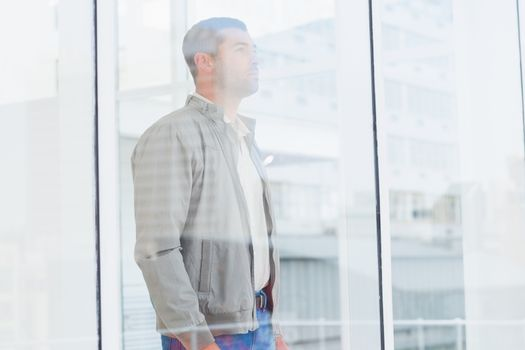 Thoughtful businessman looking thought window