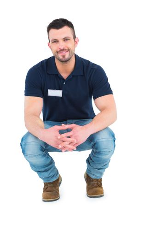 Handyman crouching