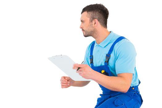 Handyman reading clipboard