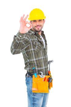 Smiling handyman gesturing okay