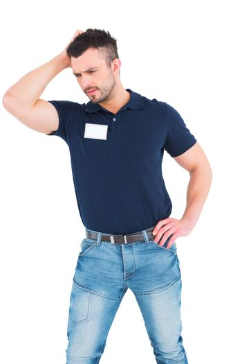 Confused male technician scratching head