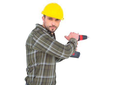 Carpenter drilling hole