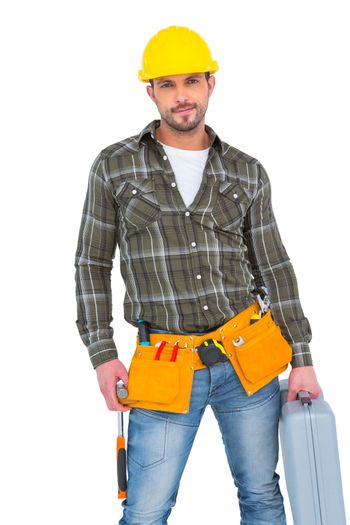 Repairman with hammer and toolbox