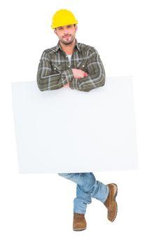 Handyman holding placard