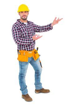 Handyman showing something