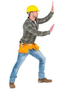Handyman pushing something