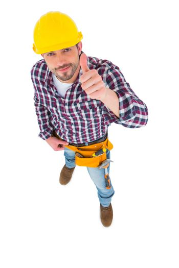 Smiling handyman with thumbs up