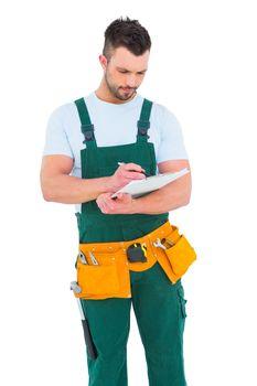 Repairman writing on a clipboard