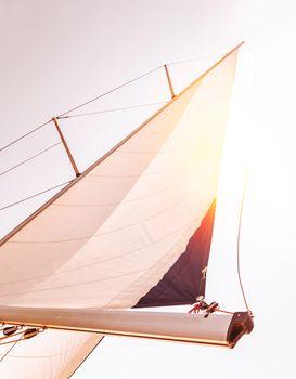 Sail over sunset sky