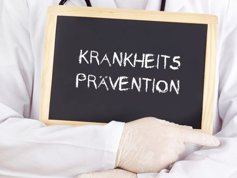Doctor shows information: preventive healthcare in german
