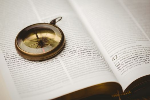 Compass on open bible