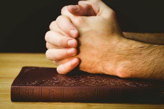 Man praying over his bible