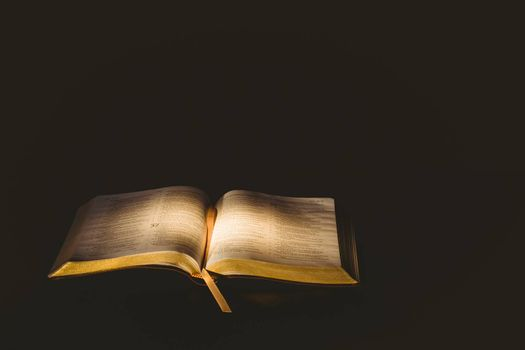 Light shining on open bible