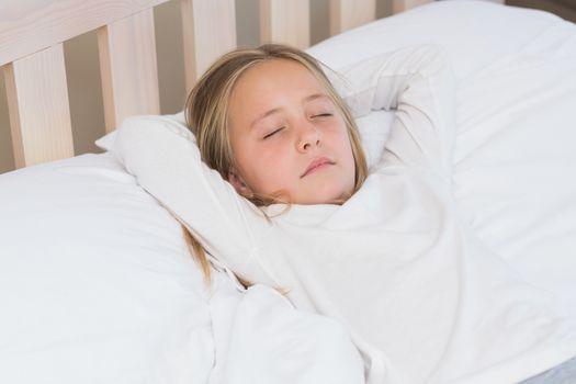 Little girl sleeping in her bed